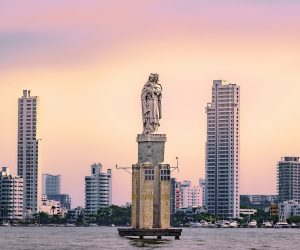 CARTAGENA COLOMBIA - JUNE 6 2015: Statue of La Virgen del Carmen of the bay of Cartagena in a beautiful sunset of reddish tones.